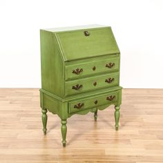 This shabby chic secretary desk is featured in a solid wood with a distressed green paint finish. This chest of drawers has a drop down desk with storage, 3 drawers and carved spindle legs. Perfect for a small entryway!  #shabbychic #desks #secretarydesk #sandiegovintage #vintagefurniture