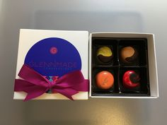 Glennmade Confections - 4 piece box of Dark Chocolate Bonbons.   Flavors include Limoncello, Espresso, Pumpkin Pie and Dark Chocolate Peanut Butter and Jelly.  For more information check out www.glennmadeconfections.com!