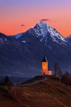 Sunrise in Church of Saints Primus and Felician, Jamnik, Julian Alps, Slovenia