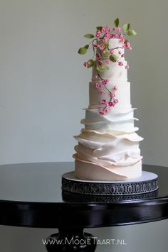 Summer blossom - Wedding cake with ombre ruffles and fuchsia blossom. By Willemke Bulder.