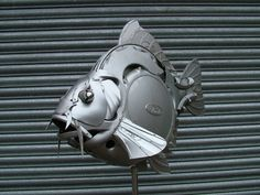 Amazing what can be done with hubcaps! The work of artist Ptolemy Elrington