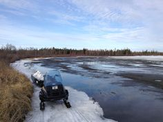Skidoo parked on a shoreline!