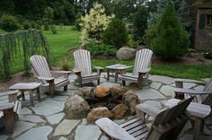 Large landscaping rocks around the fire ring in the garden
