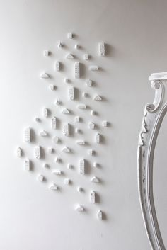 So nifty! Clay Architecture Wall Installation - Ceramic clay houses by Artisanie Europe - pure white home decor modern wall art. €800,00, via Etsy.
