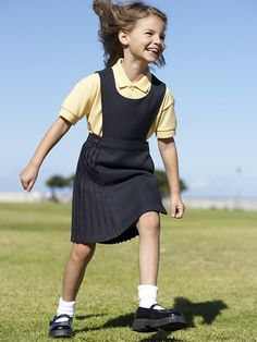 This attractive girls pinafore is simple in design but looks really good when worn. Made from 100% polyester and featuring a wrapover knife pleated skirt this is ideal for junior, infant and primary schools. The buttons can be re-seated so the waistline can be altered.  Available in Grey and Brown.