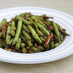 I first attempted making Sichuan dry-fried green beans 5 years ago while living in Beijing. Night after night I would have these delicious crispy green beans at Sichuan restaurants alongside dishes like mapo tofu and kung pao chicken, and finally decided I needed to try making them on my own