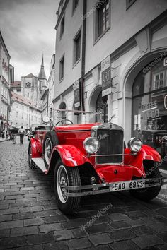 prague czech republic - 21 june 2014 - famous historic red car praga in prague street. praga is a manufacturing company founded in 1907 based in prague czech republic. Black White Red, Black And White Pictures, Photo Pop Art, Auto Retro, Splash Photography, Prague Czech Republic, Red Aesthetic, Belle Photo, Color Pop