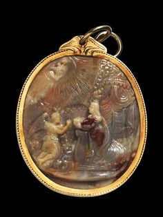 Large oval cameo, made of light brown and red speckled agate, cut double sided. A: Annunciation. B: Adoration of the Magi. North Italy, about 1500 A.D .