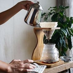 Pouring the Hario on the New Hario Olive Wood Stand & Range Server! Shop Hario Link in Bio Day Shipping Coffee Pour Over Stand, Coffee Stands, Coffee Dripper, V60 Coffee, Brew Stand, Curve Design, Brewing Equipment, But First Coffee, Drip Coffee Maker