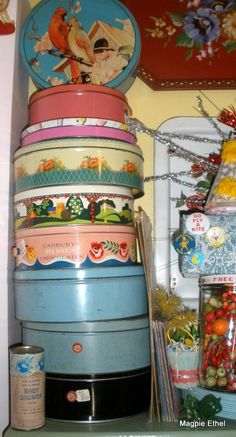 OMG! Love this stack of tins.