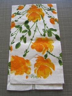 *SOLD* $22 - This is a beautiful set of Vera Nuemann cotton linen tea towels. One is brand never and never been used, the other has been laundered. These are works of art and really could be framed to hang on the wall or you can use them in your kitchen. Print features yellow and orange roses. In great vintage condition- no stains.