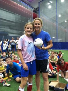 Kristine Lilly and soccer camper. (Twitter)
