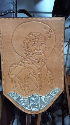Hand-carved picture with recycled saddle silver