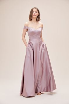 This elegant satin bridesmaid dress offers a fresh take on tradition. Luminous shine, a flattering off-the-shoulder neckline, and convenient side pockets enhance the classic A-line silhouette and add an element of sexy sophistication. Satin Bridesmaid Dresses, Strapless Dress Formal, Formal Dresses, Bridesmaids, Winter Bride, Off The Shoulder, Neckline, Gowns, Melbourne
