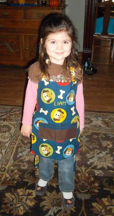 Here's a little apron I made for our grandson Liam, modeled by his sister, Gracie.  I bought the Doggie Fabric from Joann's, designed the apron myself.