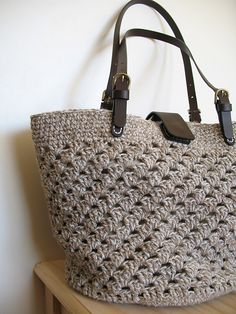 crocheted bag...example how yarn choice , size and handles make a project!