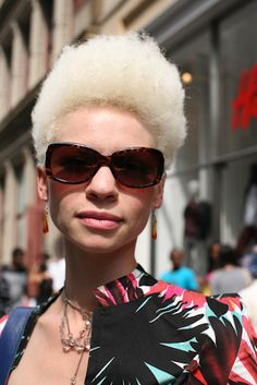 Mani DeOsushows off her hot hair in the Soho neighborhood of New York City.