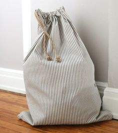 Learn to sew a simple drawstring laundry bag.