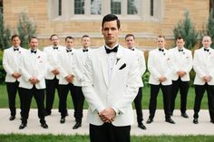 These guys had an old-Hollywood style with their stunning white suits and black bow-ties. | A Timeless and Traditional Mansion Wedding