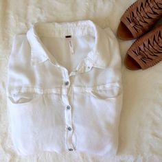 Free People Top Soft short sleeve Free People button up top with pockets.     Please make all offers through the offer button  ✨10%✨off with bundle!  Fast Shipping Non-Smoking No trades/PayPal Open to fair offers Instagram: laurentopor Tumblr: nearlynewbylo  ✨ Happy Poshing ✨ Free People Tops