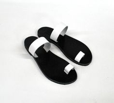 White womens sandals with black leather sole