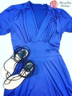 This stunning royal blue Paisley Raye dahlia dress is available now in the Messy Bun Boutique!