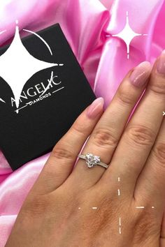 Ensure your engagement ring is unique by choosing a heart-shaped diamond. One of our most beautiful unique engagement rings, this diamond engagement ring features a heart-shaped centre diamond with even more diamonds running down either side of the band.