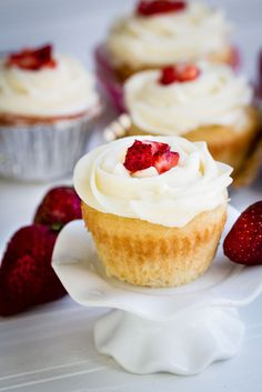 Strawberry Filled Vanilla Cupcakes make the perfect celebratory treat! Deserts With Strawberries, Strawberry Filled Cupcakes, Strawberry Filling, Vanilla Cupcakes, Yummy Cupcakes, Vanilla Buttercream, Frosting Recipes, Cupcake Recipes, Cupcake Cakes