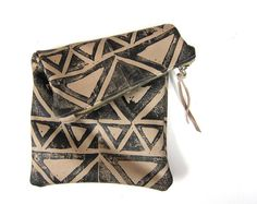 Black and tan clutch by arcofla