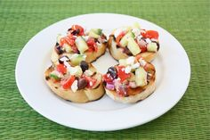greek-salad-bruschetta from two peas and their pod... looks ah-mazing!!  Summer lunch?