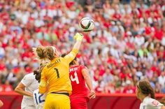 Injured: Goalkeeper Karen Bardsley punches the ball away, but she had to come off injured shortly afterwards