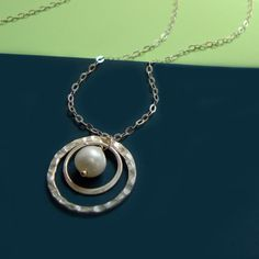 pearl and hammered silver pendant and chain