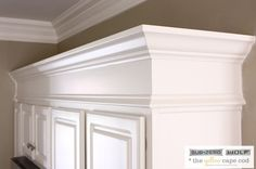 extend the height of our stock grade cabinets with trim and molding to create the illusion of tall custom cabinetry