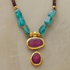 MAGNIFICANT NECKLACE. Amid pink tourmalines and apatite nuggets, Nava Zahavi hand wraps two rubies in 24kt gold.