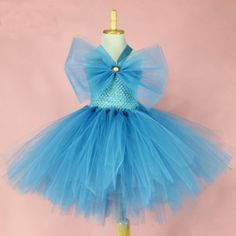 This pretty would look wonderful for a birthday.a trip to Disney or on a flower girl in a wedding. Finished with a gorgeous bow in the front and halter neck stripes adornd this dress. Girls Party Wear, Girls Wear, Cinderella Tutu Dress, Girls Tutu Dresses, Frocks For Girls, Halter Neck, Pretty Dresses, Dresses Online, Crochet Top