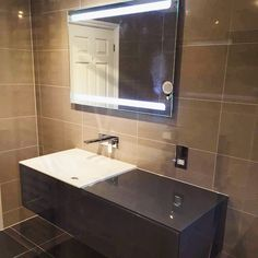 Another one of our installs, how gorgeous is this? A perfectly lit mirror for getting ready in too! #bathroom #LED #mirror #sink #tiling https://instagram.com/bathroomboutiqueltd/