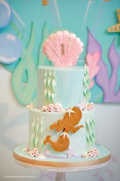 2-tier mermaid birthday cake from Pastel Mermaid Birthday Party at Kara's Party Ideas. See the ocean of details at karaspartyideas.com!
