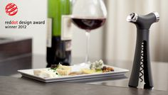 quirky - Verseur Multi Function Wine Opener with a wine spout on one end and a stopper on the other