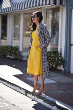 $119 Stylish Ann Taylor Yellow Halter Beck Midi Dress Teamed With $75 Topshop Gingham Trench Coat And Finished With Wayfarer Sunglasses And Classy Nude Pumps