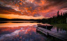 Norwegia, Region Sor Trondelag, Miasto Trondheim, Jezioro, Zachód słońca, Jezioro, Pomost, Łódka, Las, Drzewa, Chmury, Odbicie