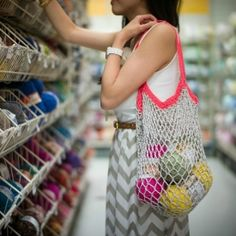 Crochet this beautiful mesh bag, perfect for the beach and grocery shopping! Step-by-step blog post and link to free pattern available!