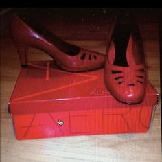 👠 Red leather heels Really comfortable, good shade of red. Worn only twice at most, in great condition. Bottoms of the shoes are unscathed.  Very confortable inside cushion for feet. Decorative cutouts at the top area of shoe. Box included. AEROSOLES Shoes Heels