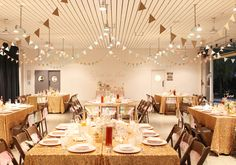 paper bunting garlands and gold sparkle linens | Photo by Kimberly Genevieve | Event planning by Beau & Arrow Events