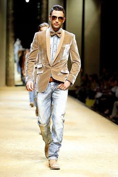 tan tuxedo jacket with a denim shirt and bow-tie