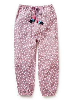 100% Viscose Pant. Harem silhouette with elasticated waist and pant cuffs. All-over floral ditsy print with multi-coloured cord and tassels at front. Relaxed fitting silhouette. Available in Bright Pink & Navy