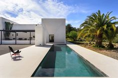 Built upon an ancient Ibizan #finca, this modern villa by Parisian architect Pascal Cheikh Djavadi stands out for its minimalism, elegance and expressive geometry #swimmingpool