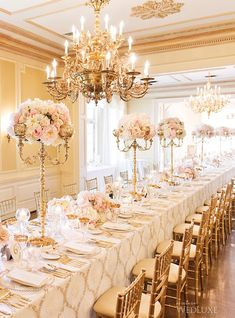 Gold and pink themed wedding table with pink flowers