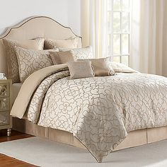The beautiful Iron Gate comforter set is adorned with classic scroll work patterning that set it apart with understated sophistication. This woven jacquard comforter has neutral tones of ivory and tan that will enhance any updated traditional décor.