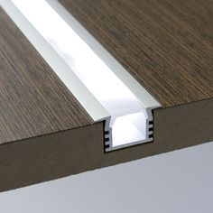 LED lights can be combined with aluminum extrusion and lens to create a beautifully recessed bar of light