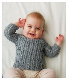 Vega is sweet little sweater knit seamlessly from the bottom up. It features a simple ribbed lace pattern, raglan sleeves and has a cute buttoned front flap.